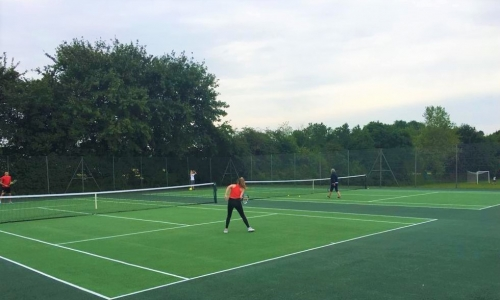 Photo of Tennis players on courts