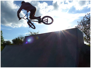 Photo of cyclist using skate park